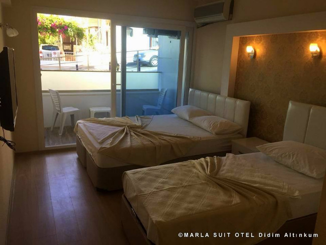 marla-suit-otel-didim-altinkum-rooms